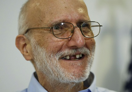 Alan Gross smiles at a news conference in Washington after returning to the United States