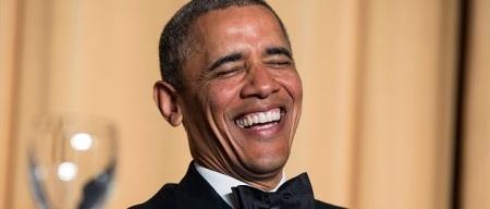 U.S. President Barack Obama laughs at a joke during the White House Correspondents' Association Dinner