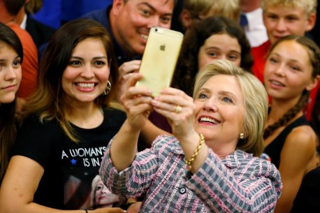 U.S. Democratic presidential candidate Hillary Clinton takes a picture with supporters during a campaign stop in Sacramento, California