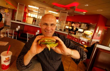 Andy Puzder, President of CKE Restaurants at a Carls Jr. Restaurant in Carpinteria with a turkey bu